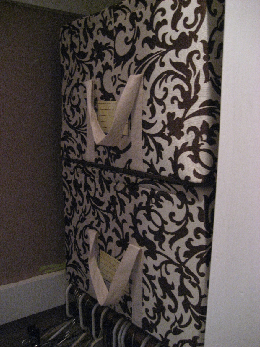 fabric boxes in the closet